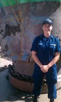 Alexandra LaRiviere in front of damaged buoy.