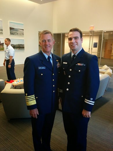 Admiral Paul Zukunft and AUP Project Manager Jacob Thayer stop for a picture at the Auxiliary's 75th Anniversary Celebration at USCG headquarters.
