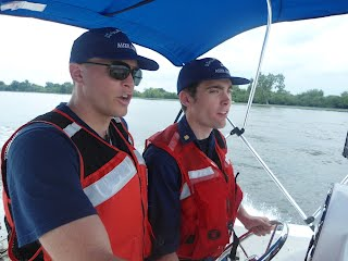 Andrew Husted, AUP Operations Project Manager, instructs Spencer Owens of AUP Unit Washington (University of Maryland) at the helm of a small vessel.