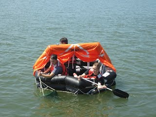 Cadets learn proper open water survival skills in the life raft.