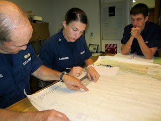 Mr. Ray Procopio, Flotilla 66 Mathews VA, provides navigation and local knowledge instruction on a nautical chart.